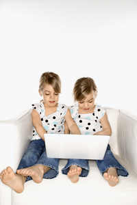 two girls in front of a computer